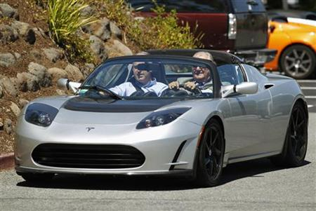 Prince Consort Henrik of Denmark tests drive a Tesla electric Roadster during his visit to the Tesla headquarters in Palo Alto
