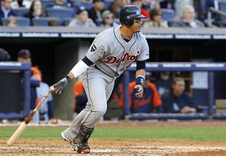 Detroit Tigers' Victor Martinez hits an RBI single against the New York Yankees in Game 2 of their MLB American League Division Series baseb