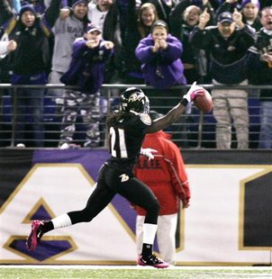 Ravens cornerback Lardarius Webb scores a touch down against the Jets in Baltimore