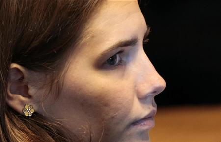 Knox, the U.S. student convicted of murdering her British flatmate Meredith Kercher in Italy in November 2007, looks on during her appeal tr