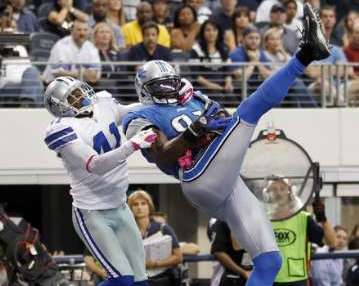 "MEGATRON DID IT AGAIN! Detroit Lions wide receiver Calvin Johnson (R) makes the catch for the winning touchdown as Dallas Cowboys cornerback Terence Newman defends in the second half of their NFL football game in Arlington, Texas October 2, 2011. It was the fourth straight week that ""Megatron"" caught two TD passes in a game. REUTERS/Mike Stone"