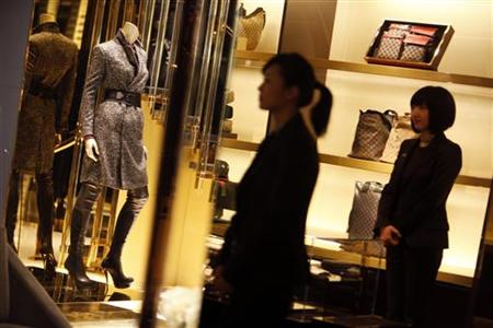 Staff members of the new Gucci flagship store in Shanghai walk around the store on its opening day
