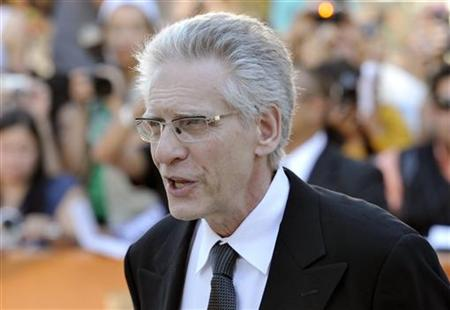 Canadian director David Cronenberg poses at the gala presentation for the film 'A Dangerous Method ' at the Toronto International Film Festi