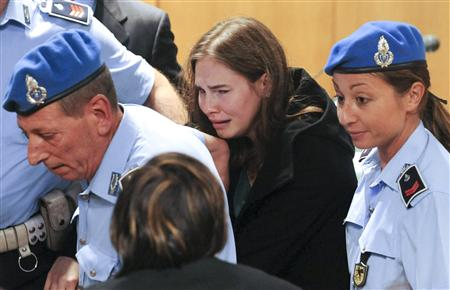 Amanda Knox reacts after hearing the verdict during her appeal trial in Perugia