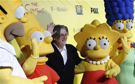 Groening, creator of The Simpsons, poses with characters from the show in Santa Monica