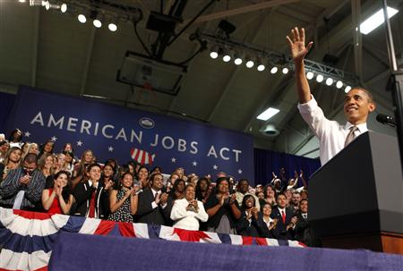 U.S. President Barack Obama waves before he speaks about the Americans Job Act at Eastfield College in Texas