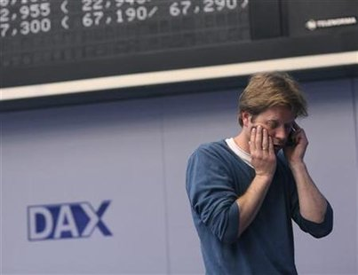 A trader uses his cell phone on the trading floor of Frankfurt stock exchange in Frankfurt