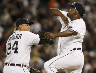 Detroit Tigers relief pitcher Jose Valverde (R) celebrates with teammate Miguel Cabrera after the Tigers defeated the New York Yankees in Game 3 in their MLB American League Division Series baseball playoffs in Detroit, Michigan, October 3, 2011. REUTERS/Rebecca Cook (UNITED STATES - Tags: SPORT BASEBALL)