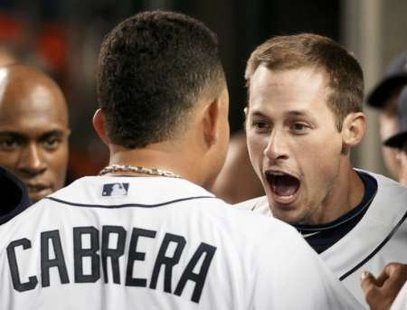 Detroit Tigers' Don Kelly (R) celebrates with teammate Miguel Cabrera after scoring in the sixth inning of Game 3 in their MLB American League Division Series baseball playoffs in Detroit, Michigan, October 3, 2011. REUTERS/Rebecca Cook (UNITED STATES - Tags: SPORT BASEBALL)