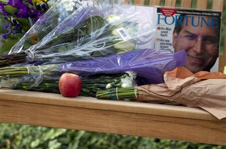 A memorial outside Apple headquarters is set on a bench following the death of Apple Inc founder Steve Jobs in Cupertino, California