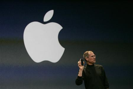 File photo of Apple Inc. CEO Steve Jobs holding new iPhone