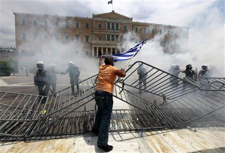 A protester taunts police in front of the parliament during violent protests in Athens' Syntagma square