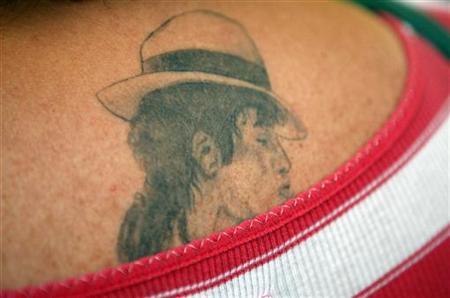 A demonstrator with a tattoo of Michael Jackson stands outside the Los Angeles Superior Court