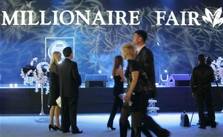 Visitors attend the opening night of the Millionaire Fair in Moscow