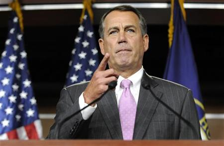 Boehner acknowledges a reporter during a news conference at the Capitol in Washington