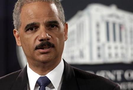 Eric Holder holds a news conference to deliver the results to date of the largest prosecution of an international criminal network organized