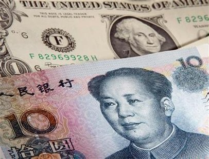 A picture illustration shows a U.S. one dollar and Chinese 10 Yuan bank notes