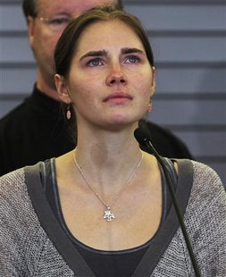 Amanda Knox pauses while speaking during a news conference at Sea-Tac International Airport