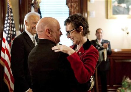 Captain Mark Kelly hugs his wife Gabrielle Giffords after receiving the Legion of Merit during Kelly's retirement ceremony in the Secretary