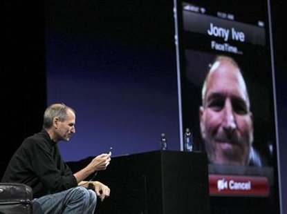 Apple CEO Steve Jobs demonstrates video conferencing with Apple Senior Vice President for Industrial Design Jonathan Ive at the unveiling of