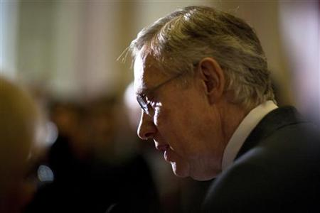 Senate Majority Leader Harry Reid speaks to the media after the U.S. Senate passed a bill allowing a rise in the debt ceiling on Capitol Hil
