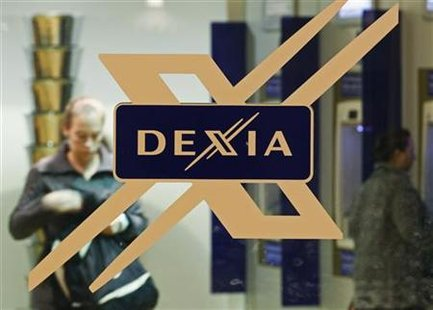 A woman walks inside a local branch of the Belgian-French financial services group Dexia in Brussels