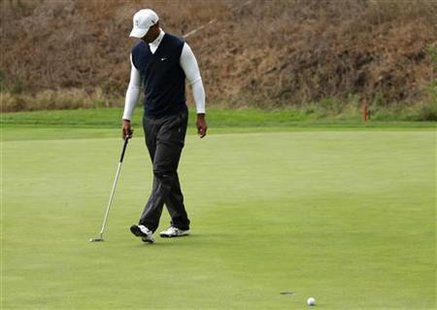 Tiger Woods reacts after missing a birdie putt at the 18th hole during the first round of a PGA Tour golf tournament in San Martin, Californ
