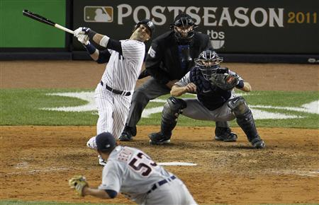 New York Yankees' Nick Swisher strikes out with the bases loaded in the seventh inning of play against the Detroit Tigers in Game 5 of their