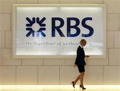 A worker walks in the foyer of a Royal Bank of Scotland office in the City of London