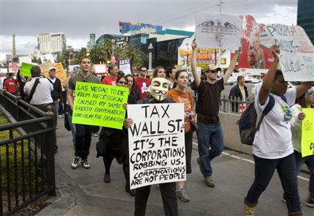"Protesters march on the Las Vegas Strip during an ""Occupy Las Vegas"" demonstration in Las Vegas"
