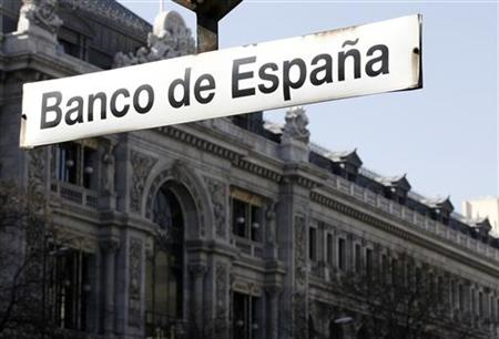 The Bank of Spain is seen behind a sign in Madrid