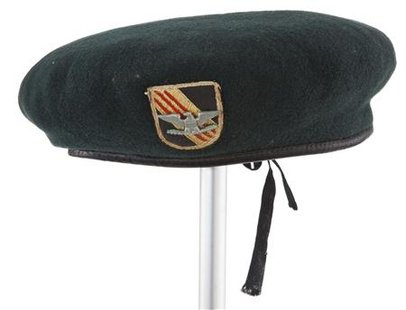 "The green wool beret which actor John Wayne wore in the 1968 film, ""The Green Berets"" sells for over $179,000 at auction"