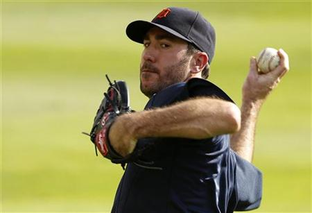 Detroit Tigers' starting pitcher Justin Verlander warms up during a practice in preparation for the MLB American League Championship Series
