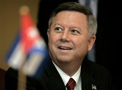 Nebraska state Governor Dave Heineman attends signing of a trade agreement with Pedro Alvarez, head of the Cuban food import agency Alimport