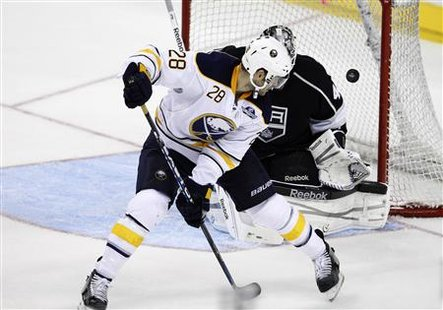 Buffalo Sabres' Paul Gaustad scores past Los Angeles Kings' goalie Jonathan Bernier during second period of their NHL hockey game in Berlin