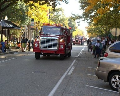 A vintage fire truck makes its way down 8th Street in downtown Holland during the 29th Holland Fire Truck Parade on Oct. 8, 2011.