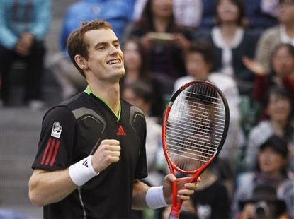 Murray of Britain celebrates his win over Nadal of Spain during their final match at the Japan Open tennis championships in Tokyo