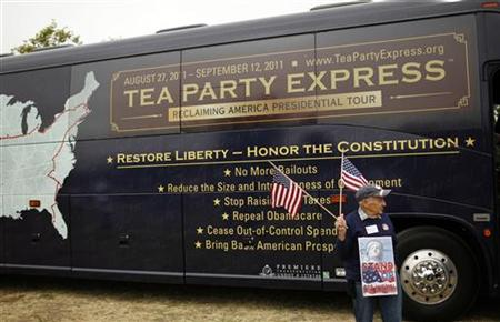 A man carries a U.S. flag during a Tea Party rally in Napa, California