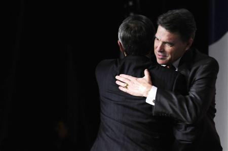 Perry hugs his presenter as he takes the stage to address the Family Research Council's Values Voters Summit in Washington