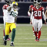 Packers tight end Finley celebrates a first down in front of Atlanta Falcons defense in the second half of their NFL football game against t