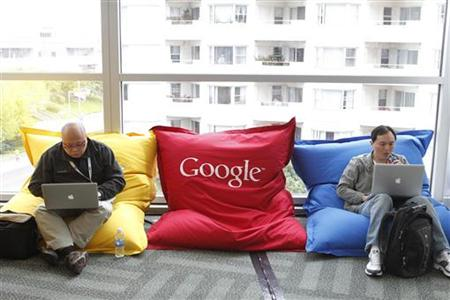 Attendees Dominie Liang and Ruslan Belkin utilize the common area at the Google I/O Developers Conference in the Moscone Center in San Franc