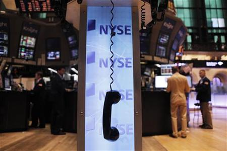 A phone hangs above the floor of the New York Stock Exchange