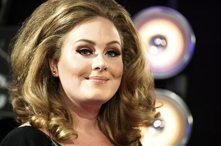Singer Adele poses on arrival at the 2011 MTV Video Music Awards in Los Angeles