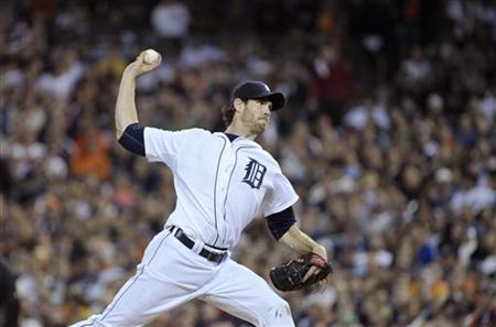 Detroit Tigers starting pitcher Doug Fister throws against the Texas Rangers in the seventh inning of Game 3 of the MLB American League Cham