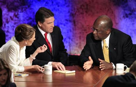 Republican presidential hopefuls Rep. Michele Bachmann, Texas Gov. Rick Perry and businessman Herman Cain talk during a break in their debat