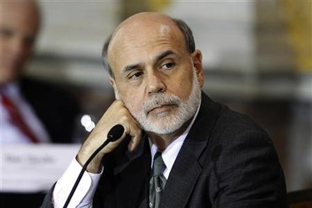 Federal Reserve Chairman Bernanke listens during an open meeting of the Financial Stability Oversight Council at the Treasury Department in