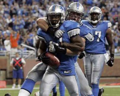 Detroit Lions RB Jahvid Best congratulated after scoring a touchdown in action at Ford Field. REUTERS/Rebecca Cook