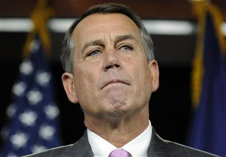 Boehner listens to a question during a news conference at the Capitol in Washington