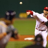 St. Louis Cardinals starting pitcher Chris Carpenter throws to Milwaukee Brewers' Corey Hart in the 1st inning of Game 3 of the MLB National