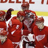 Detroit Red Wings' Howard is congratulated by teammates after beating the Vancouver Canucks to win their NHL hockey game in Detroit